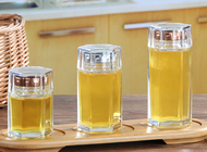 China Small Glass Honey Jars / Transparent Glass Storage Jars For Cosmetic With Lid company